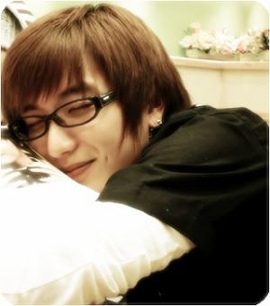 Leeteuk, omg his sleeping face is soo adorable! *glomp*